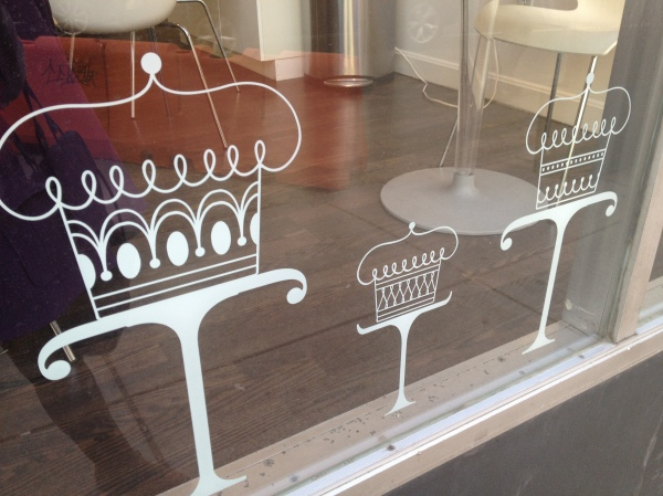 Close up of cake drawings on window